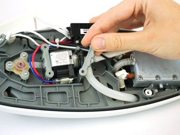 Remove both plastic pieces holding the electric valve in place.
