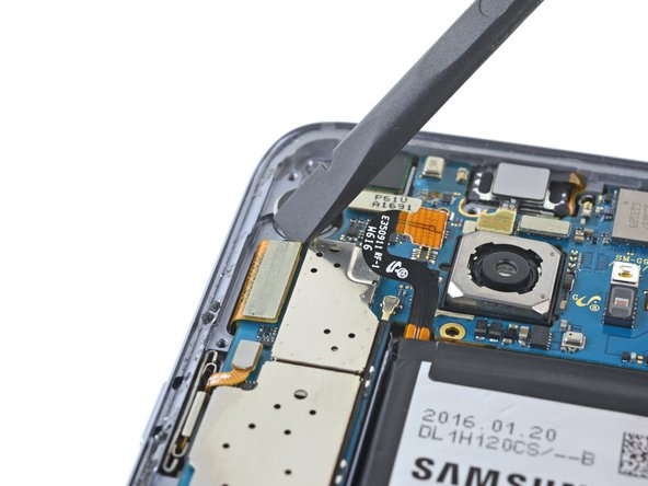 Use the flat end of a spudger to unplug the display and digitizer connector.