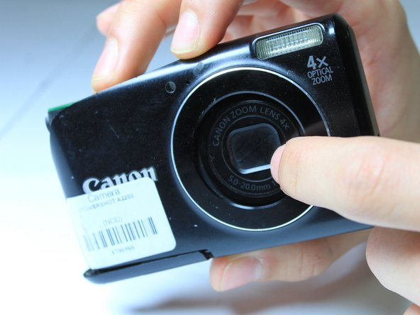 Gently press the front of the lens to begin to remove it from the frame.