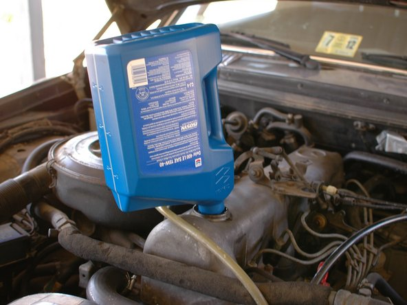 Consult your owner's manual for what viscosity to use based on your climate. Where this car is located, 15w40 works year round but a thinner oil such as 0w40 could be helpful for cold starts in very cold climates.