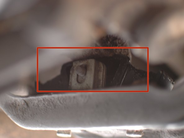 Check the transmission mount for deterioration. It is up inside the cross member just behind the front flex disc. You will have to crane your neck up to see it above the cross member.