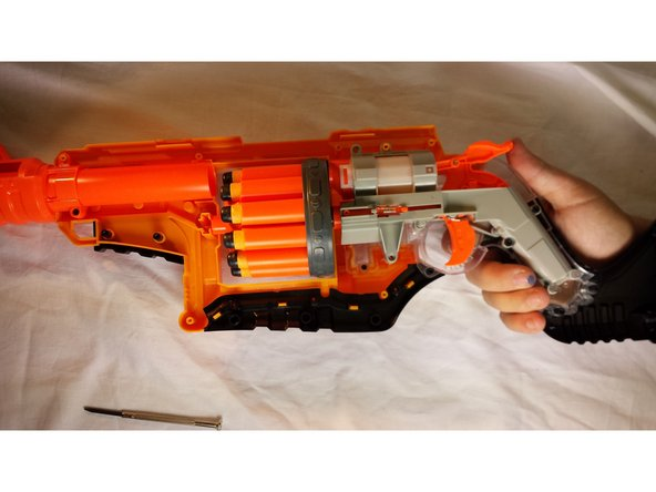 Image 1/2: Carefully reassemble the Nerf Law bringer in the same order you took it apart. Carefully reattach the 3 screws that seal the air chamber.