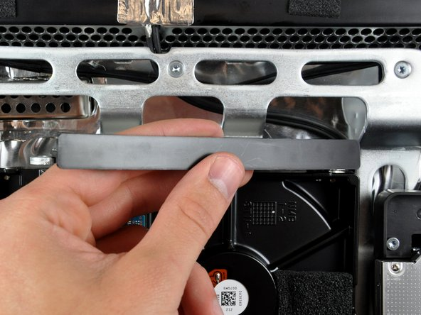Image 2/3: Lift the hard drive bracket straight up off the chassis.