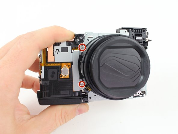Lay the camera on a flat surface while performing these steps because removing the frame causes the camera to fall apart.