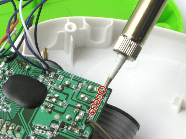 Remove the  volume control switch from the motherboard with the soldering iron.