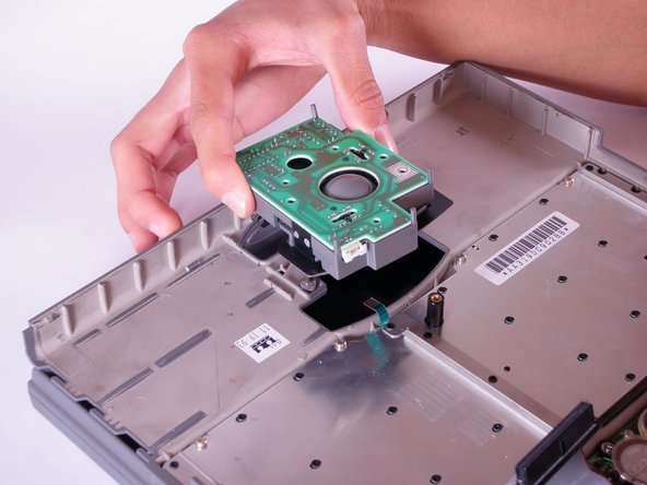 Remove all four components of the trackball assembly by lifting upward.