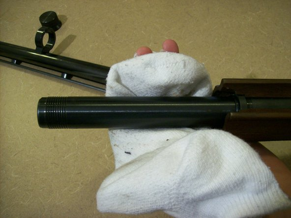 Image 3/3: Use the rag to wipe down the magazine originally covered by the fore grip.