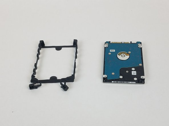Peel off the rubber hard drive mount.