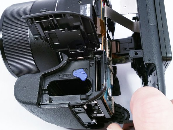 Using a plastic opening tool, separate the plastic camera housing.