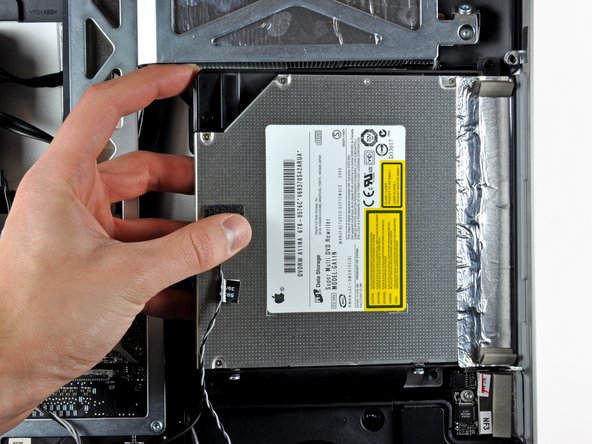 Lift the left edge of the optical drive slightly and pull it away from the right side of the outer case.