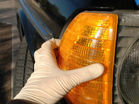 With the screw removed, pull the turn signal straight out away from the front of the car.