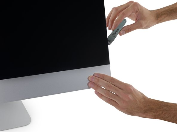 We're pretty adept at slicing open iMacs with our ever-so-fancy iMac Opening Tool and our noble Plastic Card.