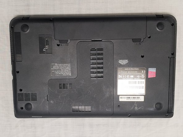 Unplug the AC adapter and all other auxiliary components from the laptop