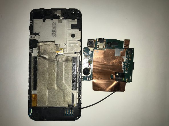 Next, the motherboard should still be connected by a wire that leads to the bottom portion of the phone.