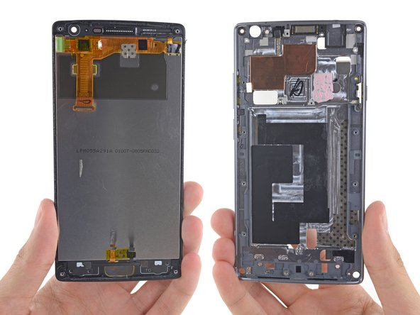 We finally get a good look at the backside of the 5.5-inch display assembly next to the now-empty shell of the midframe.