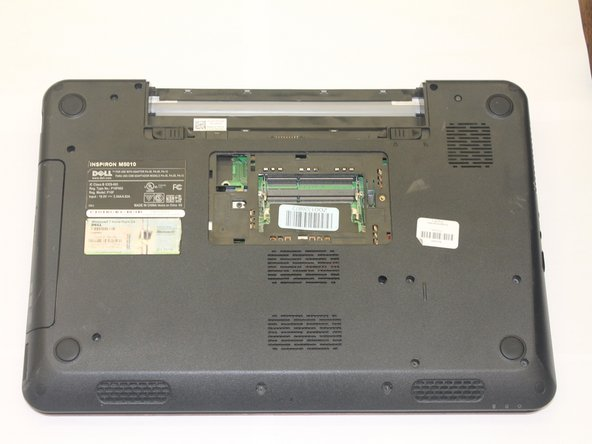 The laptop computer should look like this once both memory cards are removed.