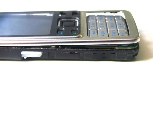 Try to seperate the front cover from the rest of the phone. The front cover is held by four plastic clips.
