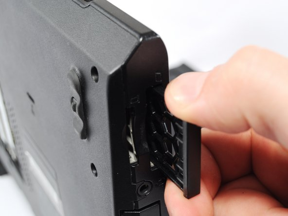 Using your thumb, press the plastic ExpressCard dummy into the case until you hear a click.