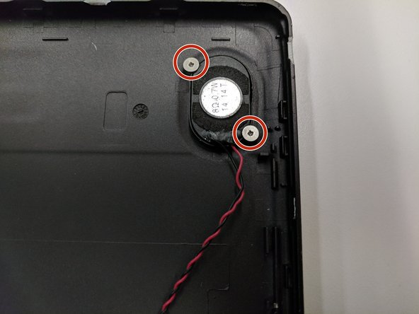 On the tablet's back cover, locate the two 4 mm screws on the speaker.