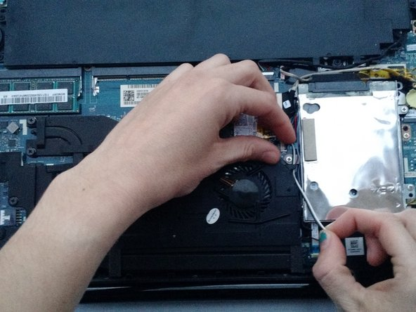 Image 1/3: Carefully unhook each grouping from the small black tabs on the fan