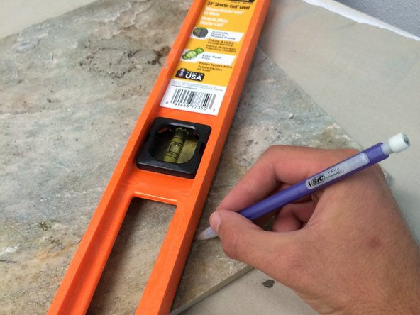 Image 2/3: Use this measurement to draw a cut-line on the tile with the pencil. Keep in mind the tile will have space between panels.