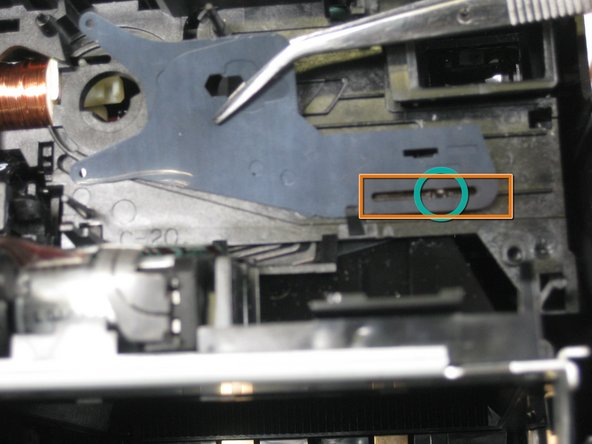 Image 3/3: Line up the slots in the shutters with the pin inside the camera as shown in the third picture.