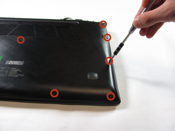 Remove all twelve 6 mm screws from the back of the laptop using a Phillips #1 screwdriver.