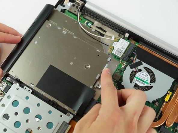 Slide the drive out of the laptop using both hands.