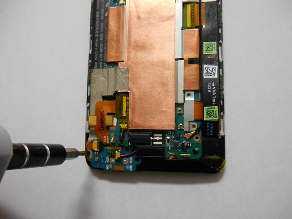 Image 3/3: Remove the screws using a T6 Torx screwdriver.