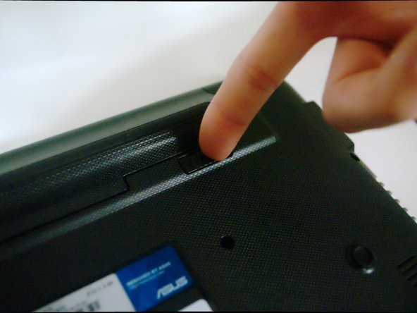 Image 2/3: Lift the battery to remove it from the laptop.