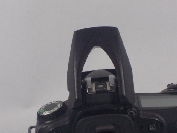 Image 2/3: Then, lift off the top casing of the flash.