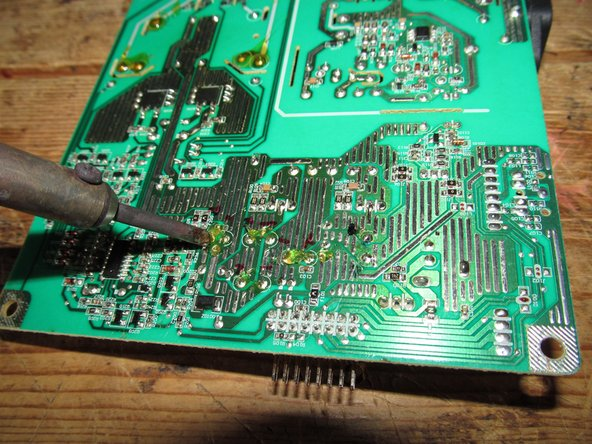 Use of a Helping Hands is recommended to avoid soldering iron contact. If you do not have one, hold the board at an angle.