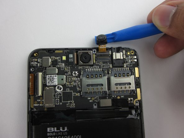 Flip up the black retaining flap on the front-facing camera ZIF connector.