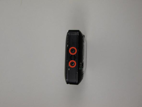 There are 2 screws located on the left side of the camera. These screw locations are depicted with the red circle markings in the photos. These screws are 2.0 mm long.