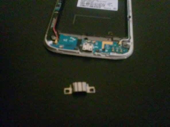 Remove clip off of USB port with a flathead screwdriver.
