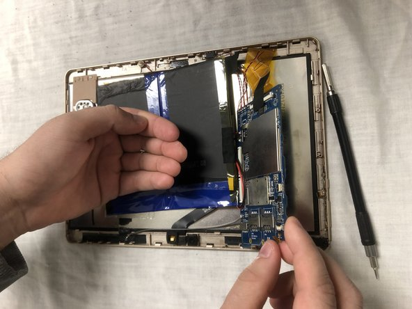Once screws are removed, carefully remove the motherboard out of encasing.