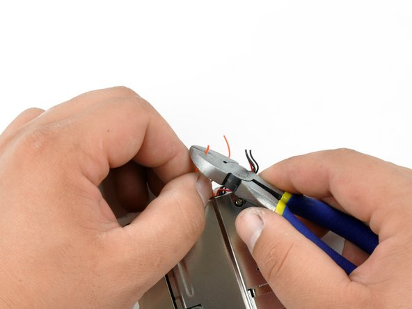 Strip approximately 5 mm off each of the wires, being careful not to accidentally sever the wires.