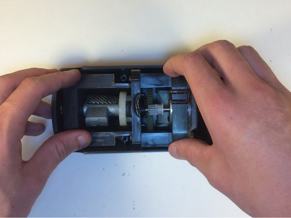 Lift the motor and cutter from the top case of the sharpener.
