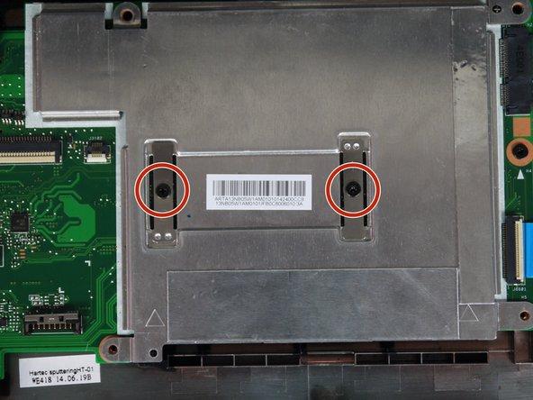 The  metal plate is held in by two 3.4mm Phillip head screws.