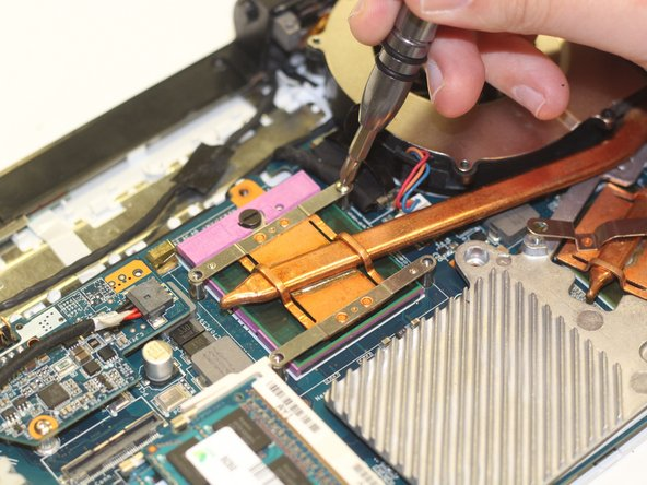 Using a Phillips #00 screwdriver, unscrew the six 2.7 mm screws that secure the fan to the motherboard.