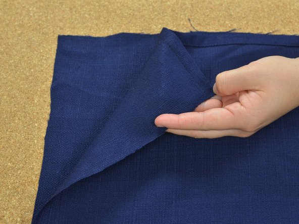 Lay the two pieces of fabric with the right sides together. Align the edges you would like to sew. Push out all the wrinkles and smooth the fabric flat.