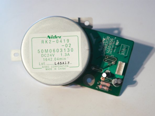"""The motor is a Nidec RK2-0419, which appears to be appears to be a fairly powerful """"outrunner"""" style brushless motor rated for 1.3A at 24V. The rotor (the round metal part) is about 3 inches in diameter and the entire motor weighs about 15 ounces."""