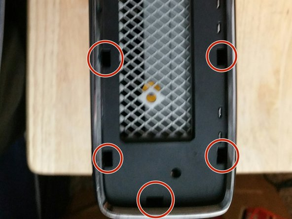 Take your flat head screwdriver and lift up on every hole like the ones circled in the picture until it comes off.