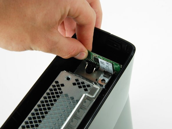 Image 2/3: Pull the Wi-Fi board out of the console.