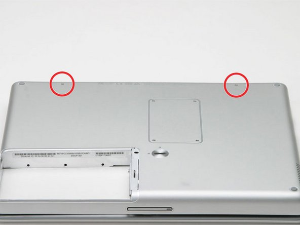 Image 1/1: Close the bottom case and turn the laptop over.