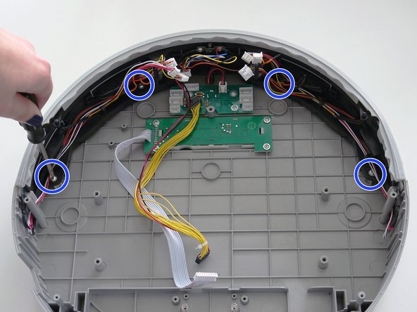 Next, remove the 4 screws connecting the bumper to bObi Pet's lid.