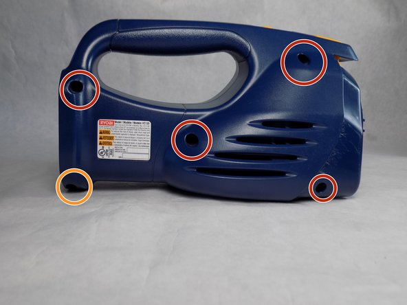 Using a  Philips head screwdriver, remove the four screws located on the side panel of the vacuum.