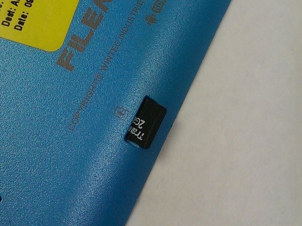 The SD card should be protruding from the slot.  If it does not pop out on its own, you may need to use tweezers to remove the drive.