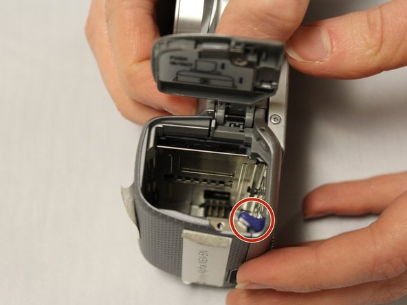 With the battery compartment latch open, locate the lock lever.
