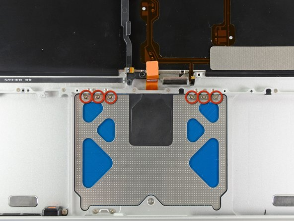 Remove the six 1.4 mm Y0 Tri-wing screws securing the trackpad to the upper case.